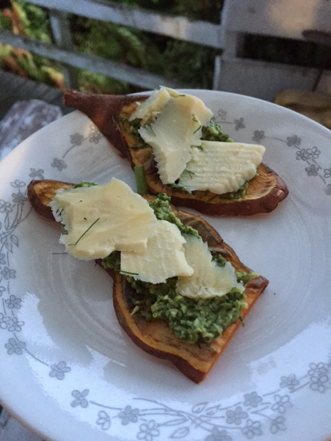 Kumara toast spread with fennel pesto and topped with tasty cheese.